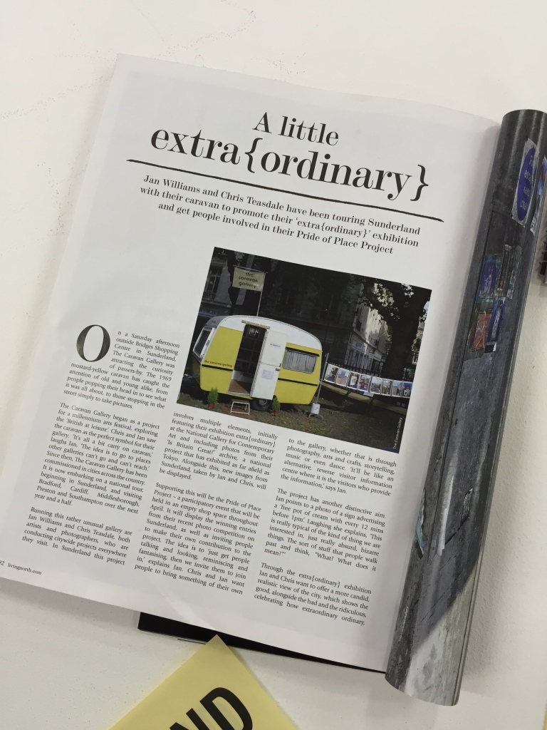 "An article about the Caravan Gallery near its inception, titled ""A Little Extra{Ordinary}"". The article features a picture of a small, travelling yellow caravan."